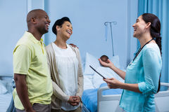 Doctor interacting with patient parents Stock Photo