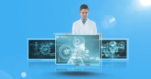 Doctor interfacing with medical screens. Digital composite of Doctor interfacing with medical screens Stock Image