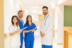 Doctor and interns standing in a hallway stock image