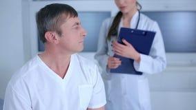 Doctor joked over the patient stock video