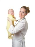 Doctor Julia and Nicolay. Woman the doctor in a white medical dressing gown with a stethoscope holds in hands of the small child in a yellow overalls isolated on Royalty Free Stock Images