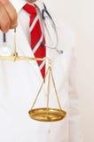 Doctor a juzgar Foto de archivo libre de regalías