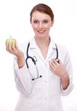 Doctor keeps an apple in the hand. Royalty Free Stock Photos