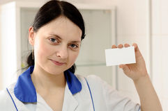 Doctor keeps  blank card in your hand Stock Images