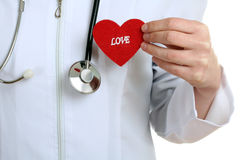 The doctor keeps the heart from a fabric Royalty Free Stock Images