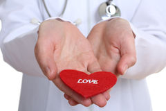 The doctor keeps the heart from a fabric Royalty Free Stock Image
