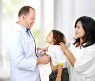 Doctor with kid Royalty Free Stock Image