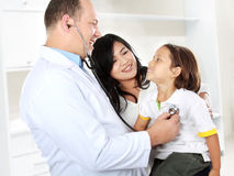 Doctor with kid Stock Photos