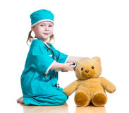 Doctor kid playing and measuring temperature toy. Girl playing doctor and measuring temperature toy royalty free stock photo