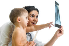 Doctor and kid reviewing X-ray Stock Image