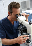 Doctor in lab making analyse with microscope Royalty Free Stock Photos