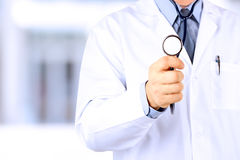 Doctor in labcoat with stethoscope Stock Photo