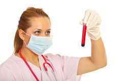 Doctor in laboratory with blood test tube Royalty Free Stock Photography