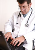 Doctor and laptop Stock Photos