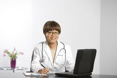 Doctor and laptop. Royalty Free Stock Photos