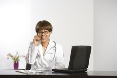 Doctor and laptop. Royalty Free Stock Images