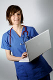 Doctor and laptop Stock Images