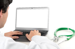 Doctor and laptop with blank screen Royalty Free Stock Photo