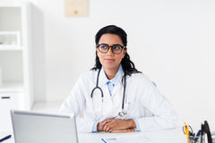 Doctor with laptop and clipboard at hospital Royalty Free Stock Photography