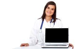 Doctor with a laptop computer Royalty Free Stock Photography