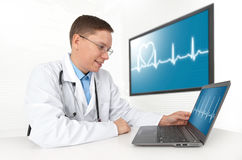 Doctor with laptop computer. Heart beat Royalty Free Stock Photos
