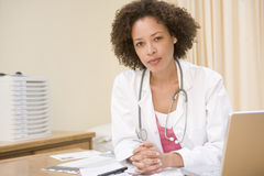 Doctor with laptop in doctor's office Royalty Free Stock Image