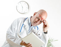 A doctor with laptop in his office Stock Photo
