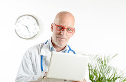 A doctor with laptop in his office Royalty Free Stock Images