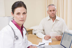 Doctor with laptop and man in doctor's office Royalty Free Stock Photography