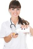 Doctor laughing with pills in her hands Stock Images