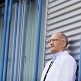 Doctor Leaning On Wall Stock Photos
