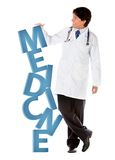 Doctor leaning on word medicine Royalty Free Stock Images