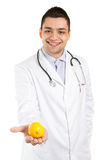 Doctor and lemon Stock Images