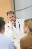 Doctor listening attentively the patients stock images