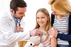Doctor listening heart beatment of little girl Royalty Free Stock Photography