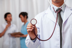 Doctor listening with stethoscope Royalty Free Stock Photos