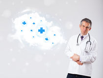 Doctor listening to abstract cloud with medical signs Royalty Free Stock Photo