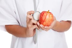 Doctor listening to an apple with a stethoscope Royalty Free Stock Photo