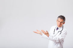 Doctor listening to empty copy space with stethoscope Royalty Free Stock Photo