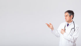 Doctor listening to empty copy space with stethoscope Stock Photography