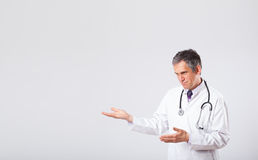 Doctor listening to empty copy space with stethoscope Royalty Free Stock Images