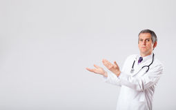 Doctor listening to empty copy space with stethoscope Stock Images