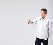 Doctor listening to empty copy space with stethoscope Stock Photos