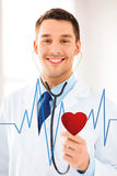 Doctor listening to heart beat. Doctor with stethoscope listening heart beat on virtual screen Stock Image