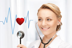 Doctor listening to heart beat. Picture of attractive doctor with stethoscope listening heart beat royalty free stock photo