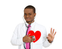 Doctor listening to heart Stock Image