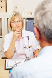 Doctor listening to patient in the office Royalty Free Stock Image