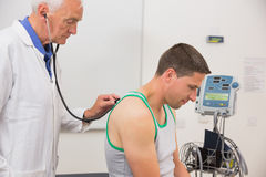 Doctor listening to patient with stethoscope Royalty Free Stock Photos