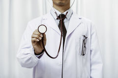 Doctor listening to the stethoscope Stock Image
