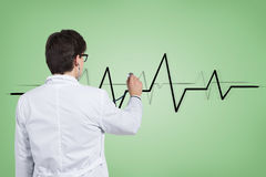 Doctor listens pulse Stock Images